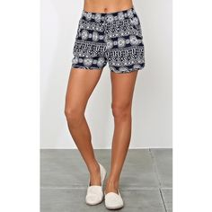 NEW. Two tone woven shorts NWT. Woven shorts featuring an elastic waistband and drawstrings. Two tone medallion border print throughout. Dolphin cut hemline with single stitching Shorts