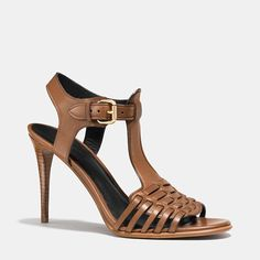 Humble huarache meets sophisticated city sandal on a design crafted in polished calf with soft leather linings, hand-woven straps and a delicate stacked heel.