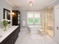 Remodeling doesn't have to be pricy. Use these 10 easy design touches to leave your master bathroom looking like new.