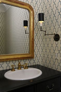 Powder Room Wallpaper Chic powder room features Phillip Jeffries Moroccan Wallpaper in Blue framing gold leaf arched ...