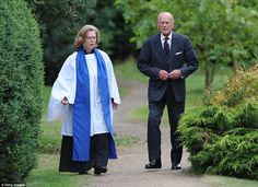 Adjusting his suit jacket: Prince Philip, Duke of Edinburgh attends a service of commemoration at Sandringham Church, near King's Lynn in No...