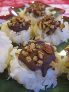 Coconut Joy Candy    Coconut Joys    1 1/2 c. flaked coconut  1 c. powdered sugar  1/4 c. butter, melted {I used less}  1 oz. milk chocolate, melted  2 Tbsp. chopped pecans    Mix the coconut, powdered sugar and melted butter. Roll into 1 in. balls. Use the end of a wooden spoon to make an indentation.. Fill with melted chocolate, sprinkle with nuts. Store in refrigerator. Bring to room temperature before serving.
