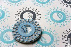 Dandelion stylised block print on unbleached cotton.