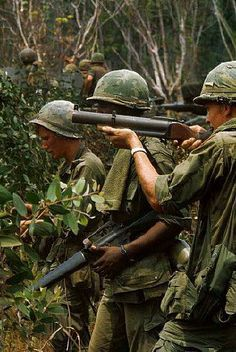 This photo shows US soldiers in the jungles of Vietnam armed with grenade launchers and m16's  they were fighting the Vietcong forces the north vietnamese that were backed by communist countries, it wasn't declared a defeat but the war lasted for to long and so many soldiers were wounded, captured or killed so they had to eventually pull out and was very embarrassing for a country of that size couldn't control country so small but fierce.