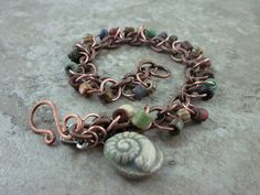 Rustic Beaded Charm bracelet with Ceramic Ammonite by skyejewels, $38.00