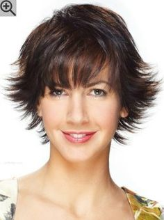 Short hairstyle with feathery layers and highlights. Styled with flipped out ends for volume.