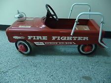 1950's pedal car fire fighter engine no. 505--ours was another yeard-sale special missing the rails on the back, and pop made several repairs before we could use it. I never realized it was as old as pop!