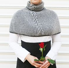 Ravelry: gray reversible cabled capelet pattern by Evelyn Siatra