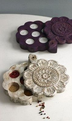 Traditional Indian spice boxes with lids that slide back to reveal hidden recesses. Made of waxed, stained wood ~ Plumo Ltd: