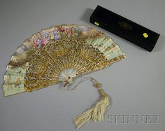 <b>19th Century French Mother-of-Pearl Fan,</b> hand-painted embellishment on kidskin, tricolor gold inlay on mother-of-pearl sticks, in wooden box.
