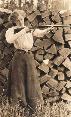 The sporting woman of the 1890s. Great Gibson Girl, maybe a great shot. Oh, she split all that wood too.