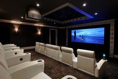 Home theater room paint color - I love these dark walls with the contrast chairs!