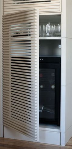 slat panel privacy screen to hide wine fridge in wet bar Condo Living, Home Living Room, Airing Cupboard, Zen House, Small Laundry Rooms, Decorating Small Spaces, Creative Home, Furniture Projects, Interior Design Inspiration