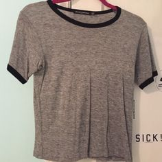 Brandy Melville Top Cute Brandy Melville top, gray with black details. Excellent condition. Best fits a size Small. Brandy Melville Tops Tees - Short Sleeve