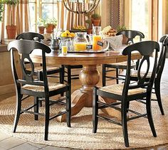 Sumner Extending Pedestal Dining Table #potterybarn I love the styling with the dark chairs and the lighter wood.