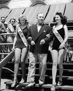 The Mayor (C) escorting Miss America 1940 (R) & Miss Atlantic City 1941 on the boardwalk at the resort & convention city. - Alfred Eisenstaedt 1941