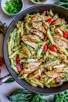 30 Minute Pesto Penne with Chicken and Cherry Tomatoes from The Food Charlatan. This 30 Minute Pesto Penne Chicken is your new favorite last minute dinner! It's done so quick, you can even used canned chicken if you are really crunched for time. Swap the frozen green beans and cherry tomatoes for whatever veggies you have on hand! #pesto #pasta #cherrytomatoes #easydinner #fast #greenbeans #chicken #penne #basil #greenonions #mayonnaise #skillet #dinner #easydinner #healthy #healthydinner