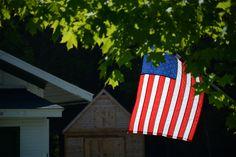 I love how the flag looks illuminated from the sun