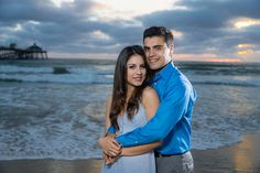 Engagement photos taken at Imperial Beach with the pier in the background.