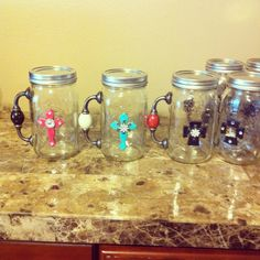 Mason jar mugs - these would be fun for a future craft or even to do for a MNO. Could even get actual mason jar mugs with the handles already part of the glass and just adorn with a cross or other pretty accents. Mason Jar Projects, Mason Jar Crafts, Bottle Crafts, Mason Jar Mugs, Mason Jar Diy, Cute Crafts, Crafts To Make, Diy Crafts, Diy Cadeau Noel