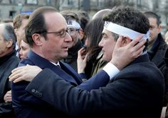 Tears, Cheers But No Fear at Paris Rally - A metro driver rallies a packed train, a crowd applauds and cheers the police and a heartbroken man falls sobbing into President Francois Hollande's arms.