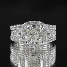 5.01ctw #Cushion Dimond with #brilliant Round Diamonds set in white #gold setting #engagement