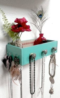 DIY painted drawer (as old sewing machine drawer) with added knobs  and cup hooks for decorative shelf