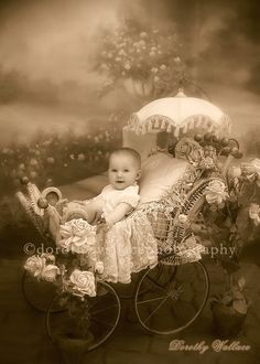 Adorable baby, elaborate carriage. The carriage is most likely taken from the photographer's props.