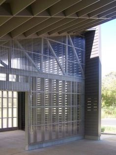 corrugated polycarbonate paneling - great use to expose structure behind.