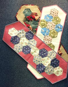 As seen on TV, the new Hexagon Table Runner pattern is now available to buy online or in store! It is a stunning design and adds that little bit of class to any table or sideboard, for just Table Runner Pattern, See On Tv, Different Fabrics, Sideboard, Table Runners, Sewing Patterns, Templates, Store, How To Make