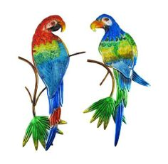 Pair of Brightly Painted Tropical Bird Metal Wall Hangings by Things2Die4. $24.99. 17 1/2 inches tall X 8 1/2 inches wide. Bright Metallic Enamels. Made of Metal. This wonderful pair of metal wall hangings features brightly colored tropical birds perched on tree limbs. Each bird measures 17 1/2 inches tall, approximately 8 1/2 inches wide and about 3/4 of an inch thick. They have metal heads and tail feathers, and the bodies are made of painted glass. They make...