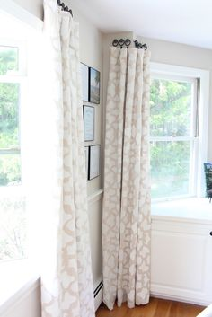 best dropcloth curtains! Love the way she hung them too.. perfect for my bay windows!