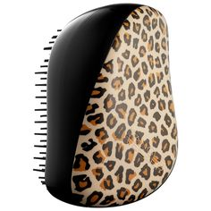 What it is:A unique, palm-sized detangling brush with a protective cover.  What it does:Tangle Teezer is an innovative tool that painlessly and easily removes tangles and knots as it styles and dries hair. The uniquely designed teeth flex and flick