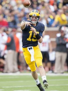 Michigan Wolverines quarterback Jake Rudock throws