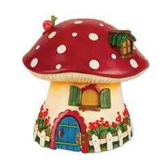 This welcoming red mushroom cottage is fit for a magical fairy forest. The blue door opens to reveal a friendly frog and its solar panel allows the windows to glowly softly in the dark. Features all-w