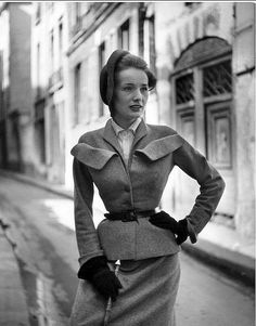 1949 - Christian DIor wool suit, jacket is fitted with black leather belt and large flap pockets high up, by Gordon Parks, Paris