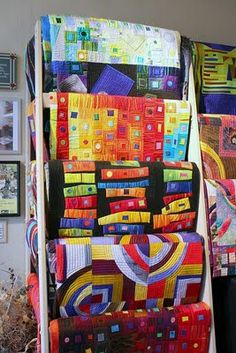 Old ladder to hold quilts. but the colors of quilts.... nice