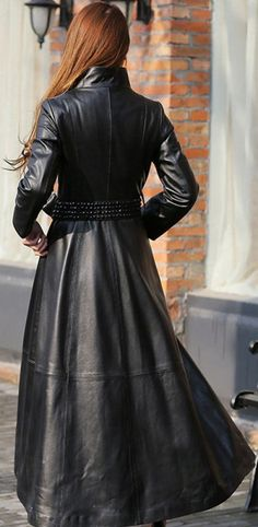 Redhead in belted long leather trench coat