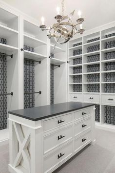 Well appointed white and gray walk-in closet features A Visual Comfort Armillary 6 Light Chandelier hung above a white center island fitted with an x-trim and contrasted with a black countertop and matte black pulls. Master Closet Design, Walk In Closet Design, Master Bedroom Closet, Closet Designs, Master Closet Layout, White Bedroom, Bedroom Into Dressing Room, Attic Master Suite, Bedroom Closet Storage