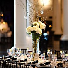 Tall Hydrangea Centerpieces - A mix of high and low centerpieces to add different levels to the reception space. For the tallest centerpieces, curly willows (with hanging votive candles) extended from hydrangea-filled cylinders. Curly Willow Centerpieces, Branch Centerpieces, Wedding Centerpieces, Hydrangea Centerpieces, Tall Centerpiece, Trendy Wedding, Our Wedding, Wedding Ideas, Wedding Decor