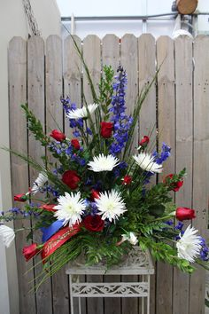 Red, White, & Blue Fresh Flower Arrangement  This is a wonderful patriotic funeral piece.
