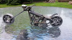 This is a really cool hand made motorcycle chopper I built. The majority of this piece is made from discarded motorcycle parts! The frame, forks, and handle bars are made from motorcycle spokes. The wheels are made from used engine bearings. The headlight and air cleaner are Harley