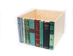 Glue old book spines to a wooden crate for hidden storage. This one is from etsy, but I think this would be a very doable DIY project.