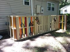Pallet fence to hide the air conditioner and gas pipes.
