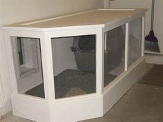 Garage litter box enclosed area, good idea for the next house. Maybe instead of a littler box a dog kennel so that they can go in and out as they please