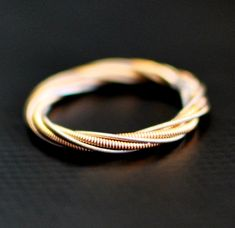 Guitar String Ring, Different Strings Twisted Together, Any Size on Etsy, $16.00
