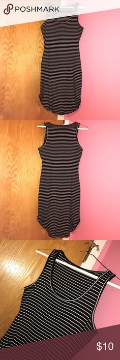 Ribbed black and white striped tight shirt/dress Tight fitting. This can be worn either as a shirt, dress, or bathing suit cover up! Worn only once. Will make offers! Tops Tank Tops
