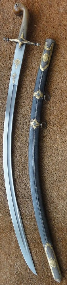 Ottoman kilij, 19th century, wootz steel blade ( visible in the groove) with 4 cartouches of koranic verses, iron mounts and spiral stiched leather scabbard decorated en suite with gold koftgari foliages and volutes, horn grip (possibly rhino horn).