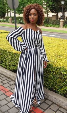 This maxi dress is perfect for every occasion- all summer long.   With the use of stripped chiffon, this long sleeved dress with off the shoulder flows perfectly exposing the front slits with every movement.