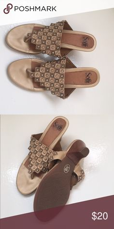 Ladies Sofft leather sandals size 9.5 Beautiful Sofft dressy leather sandals with gold accents. Leather and wood heels in good condition. These are marked 9.5M, but they run a little wide. Sofft Shoes Sandals